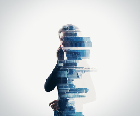 Portrait of young woman holding her smart phone in a hands. Isolated, double exposure.