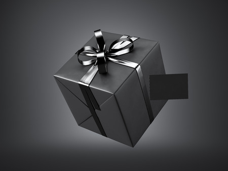 black ribbon bow: black gift box with black ribbon bow and blank business card, isolated on black. Stock Photo