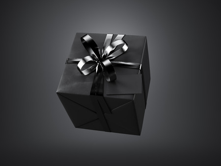 Black gift box with black ribbon bow and blank business card, isolated on black background.