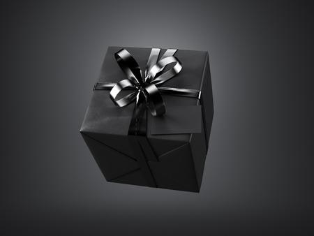 Zwarte cadeau doos met zwarte lint boog en blanco visitekaartje, geïsoleerd op zwarte achtergrond.