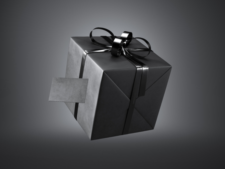 black ribbon bow: Black gift box with black ribbon bow and blank business card, isolated on dark.