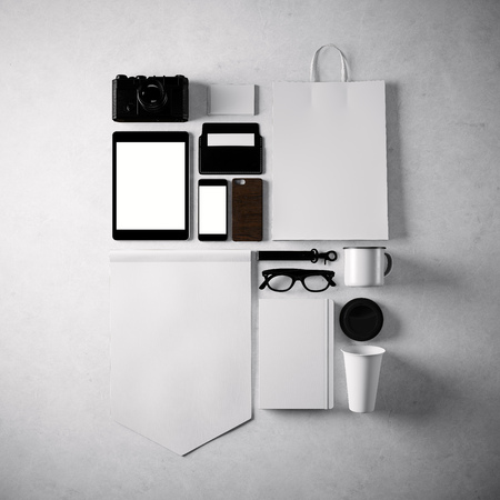 design objects: Set of blank generic design office objects on the  concrete wall  background. Square, top view.