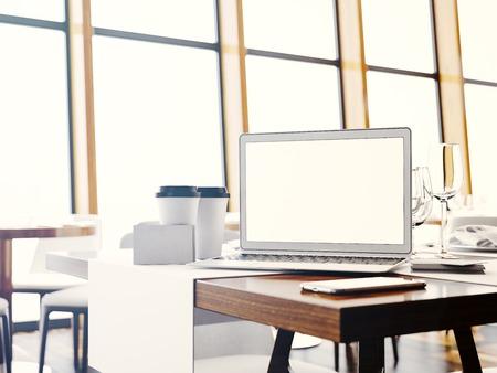 cafe internet: Generic design laptop in modern interior. Blurred background. Horizontal