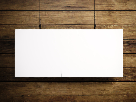 print design: Photo of blank white canvas hanging on the wood background.