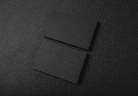 business card design: Photo of two stack Of blank black business cards on textile background. Horizontal