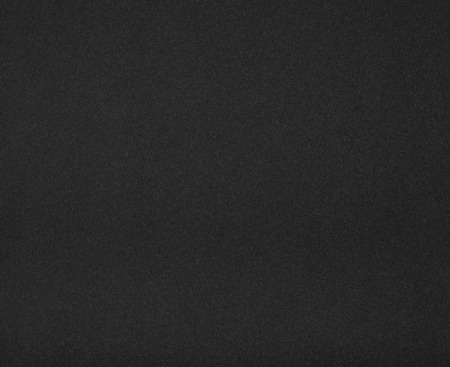 Highly detailed and empty black paper background.