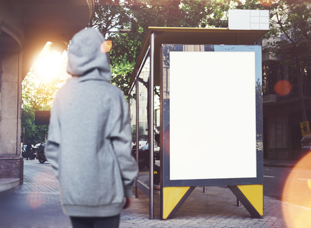 lightbox: Photo of girl looking at empty lightbox on the bus stop. Stock Photo