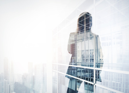 Photo of businesswoman. Double exposure, city on the background. Blurred background 스톡 콘텐츠