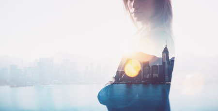 Photo of businesswoman. Double exposure, city on the background. Blurred, horizontal Stock Photo
