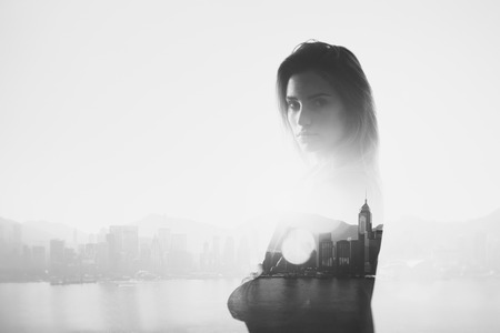 Photo of businesswoman. Double exposure, city on the background. Blurred, horizontal Imagens