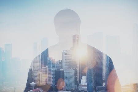 close up view: Photo of young man looking on the city, sunrise. Double exposure background, visual effects