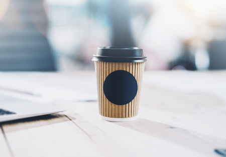 liquid material: Photo of blank craft paper coffee cup on the wood table. Space for you advertising. Horizontal mockup Stock Photo
