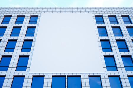 display advertising: Photo large blank billboard, display on modern skyscraper in center big city for advertising
