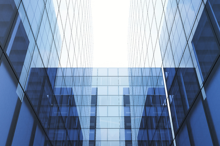 Perspective and underside angle view to textured background of modern glass blue building skyscrapers. Horizontal mockup.