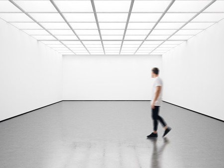 Photo of girl in modern gallery looking at the blank canvas. Horizontal Reklamní fotografie