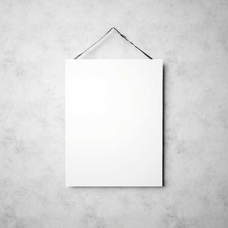 Photo of blank white canvas hanging on the empty concrete wall background. Square mockup. Фото со стока
