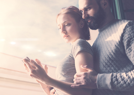 bloggers: Adult couple summer journey. Photo woman and bearded man using mobile phone. Girl touching screen contemporary smartphone.