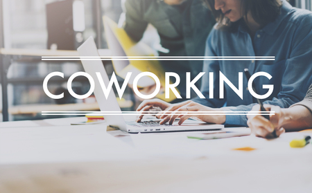 working team: Team succes, coworking world. Photo young business managers  working with new startup project in modern loft. Analyze plans. Contemporary notebook  wood table, typing laptop, papers, documents. Stock Photo