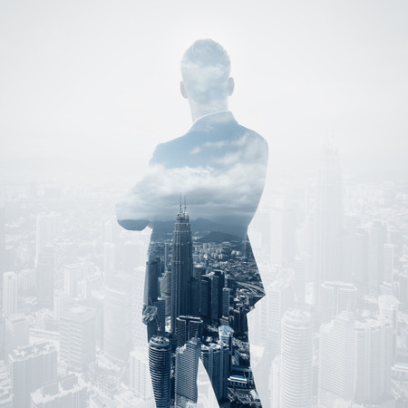 Photo of stylish adult businessman wearing trendy suit and looking city. Double exposure, panoramic view contemporary City background.