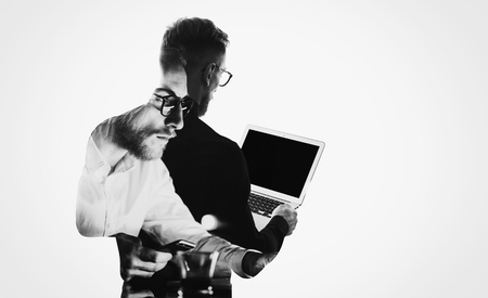 Double exposure young bearded  banker wearing black shirt and holding contemporary notebook hands.Blank screen ready for you message.Isolated white,portrait man background. Imagens