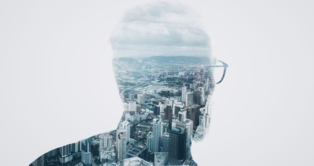 councilor: Photo of stylish bearded banker wearing trendy suit and looking city. Double exposure, panoramic view contemporary megalopolis background. Space for your business message.  Isolated white.