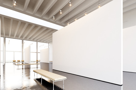 Photo exposition modern gallery. Huge white empty canvas hanging contemporary art museum.Interior industrial style with concrete floor,spotlight,generic design furniture and building