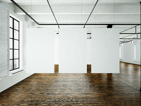 Modern art museum expo in loft interior. Open space studio.Empty white canvas hanging.Wood floor, bricks wall, panoramic windows.Blank frames ready for bussiness information.Horizontal.