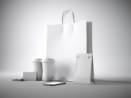 paper bag: Set of white shopping bag, two coffee cups, business cards and generic design smartphone. Light background