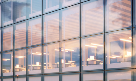 View of modern skyscraper. Modern office interior in night time. Panoramic windows facade background, contemporary business center. Empty meeting room. Real horizontal mockup,flares.