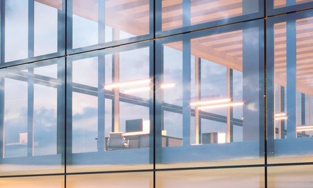 Corporations: Closeup photo of modern business center.High floor office, interior in evening time. Panoramic windows facade background, contemporary building. Empty meeting room.Horizontal,flares.