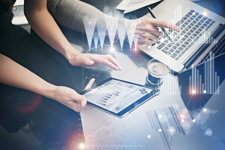 risk analysis: Photo female hands holding modern tablet. Risk managers working new private banking project in office. Using electronic devices. Graphics icons, worldwide stock exchanges interface.