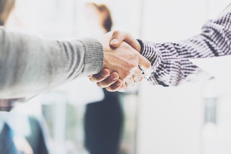 business partnership: Business partnership meeting. Picture businessmans handshake. Successful businessmen handshaking after good deal. Horizontal, blurred