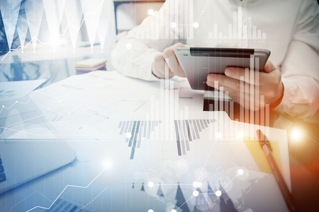 Banker manager working process.Trader work market report modern tablet.Using electronic device.Graphic icons,exchange report,worldwide stock exchanges interface.Business startup.Horizontal