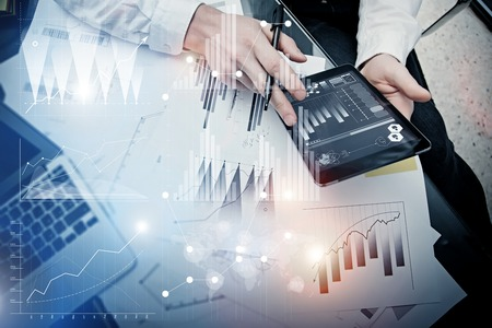 Investment banker working process.Picture trader work market report modern tablet.Use electronic device.Graphic icons,stock exchange reports interfaces.Business project startup.Horizontal