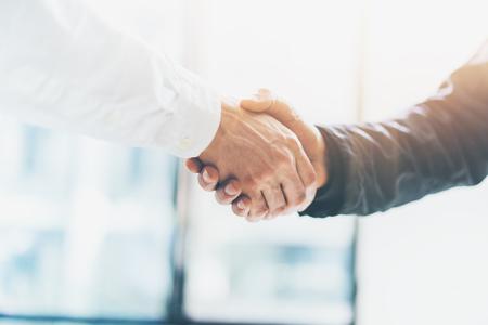 Business partnership meeting. Picture businessmans handshake. Successful businessmen handshaking after good deal. Horizontal, blurred