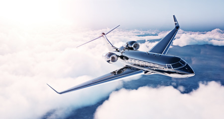 Image of black luxury generic design private jet flying in blue sky at sunrise. Huge white clouds background. Business travel concept. Horizontal .