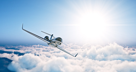 Concept of black luxury generic design private jet flying in blue sky at sunset. Huge white clouds background. Business travel photo. Horizontal , angle view. Stock Photo