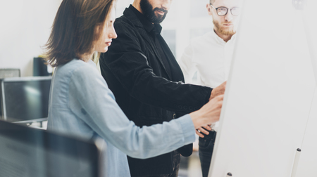 business idea: Business meeting photo.Photo man writing statistic info chart board.Photo creative department working with new startup project. Idea presentation,analyze plan,brainstorming. Film effect.