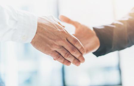 business partnership: Business partnership meeting. Photo businessmans handshake. Successful businessmen handshaking after good deal. Horizontal, blurred background, film effect. Stock Photo