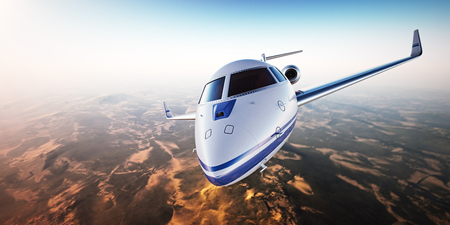 illuminator: Closeup. Realistic image of White Luxury generic design private jet flying over the mountains. Empty blue sky with sun at background. Business Travel Concept. Horizontal.