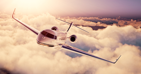 private airplane: Realistic photo of White Luxury generic design private airplane flying over the earth at sunset. Empty blue sky with huge white clouds  background. Business Travel Concept. Horizontal. Stock Photo