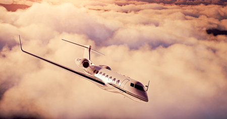 private airplane: Realistic picture of White Luxury generic design private airplane flying over the earth at sunset. Empty sky with abstract white clouds  background. Business Travel Concept. Horizontal. Stock Photo