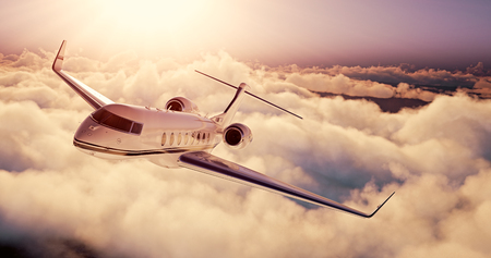 private airplane: Realistic picture of White Luxury generic design private airplane flying over the earth at sunset. Empty blue sky with huge white clouds  background. Business Travel Concept. Horizontal.