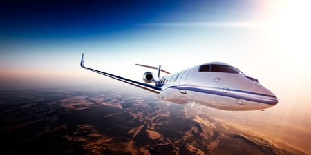 Realistic photo of White generic design private jet flying over the mountains.Empty blue sky and sun at background.Business Travel by modern Luxury aircraft.Horizontal,side view closeup.