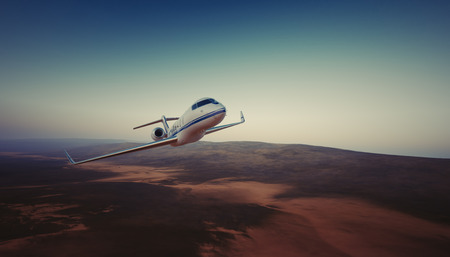 Photo of White Luxury Generic Design Private Jet Flying in Sky under the Earth Surface. Uninhabited Desert Mountains Background. Business Travel Picture. Horizontal. Film Effect. 3D rendering