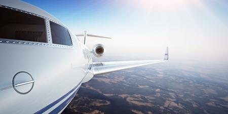 chorro: Closeup Foto cabina piloto blanco de lujo de diseño genérico Avión privado volando en el cielo azul al atardecer.Uninhabited Desert Mountains Background.Business Viajes Picture.Horizontal, la película Effect.3D rendering Foto de archivo