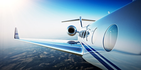 Closeup Photo of White Luxury Generic Design Private Aircraft Flying in Blue Sky at sunrise.Uninhabited Desert Mountains Background.Business Travel Picture.Horizontal,Film Effect. 3D rendering Stock Photo