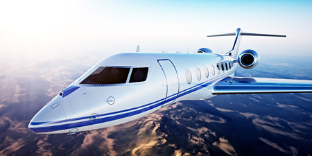 Image of White Luxury Generic Design Private Jet Flying in Blue Sky at sunset.Uninhabited Desert Mountains Background.Business Travel Picture.Horizontal,Film Effect. 3D rendering