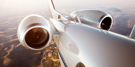 Photo of White Luxury Generic Design Private Jet Flying in Blue Sky at sunrise.Closeup Picture of two Reactive Turbine.Mans world.Full power.Business Travel Picture.Horizontal,Film Effect.3D rendering Banque d'images