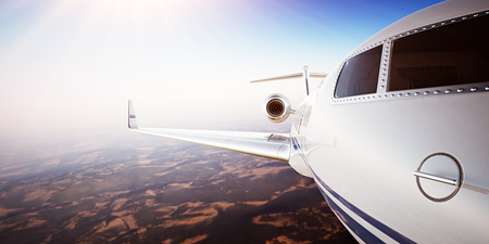 illuminator: Closeup Photo Pilot Cabin White Luxury Generic Design Private Jet Airplane Flying Blue Sky at sunset.Uninhabited Desert Mountains Background.Business Travel Picture.Horizontal,Film Effect.3D rendering